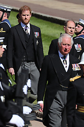 Members of the Royal family, (left to right) the Duke of Sussex, the Earl of Wessex and the Prince of Wales, follow the coffin of the Duke of Edinburgh, as it passes through the Parade Ground, during his funeral at Windsor Castle, Berkshire. Picture date: Saturday April 17, 2021.