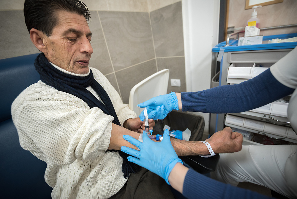 24 February 2020, Jerusalem: 60-year-old Sameer Ibrahim Karajaha from Ramallah, gets ready for Chemotherapy treatment at the Augusta Victoria Hospital.