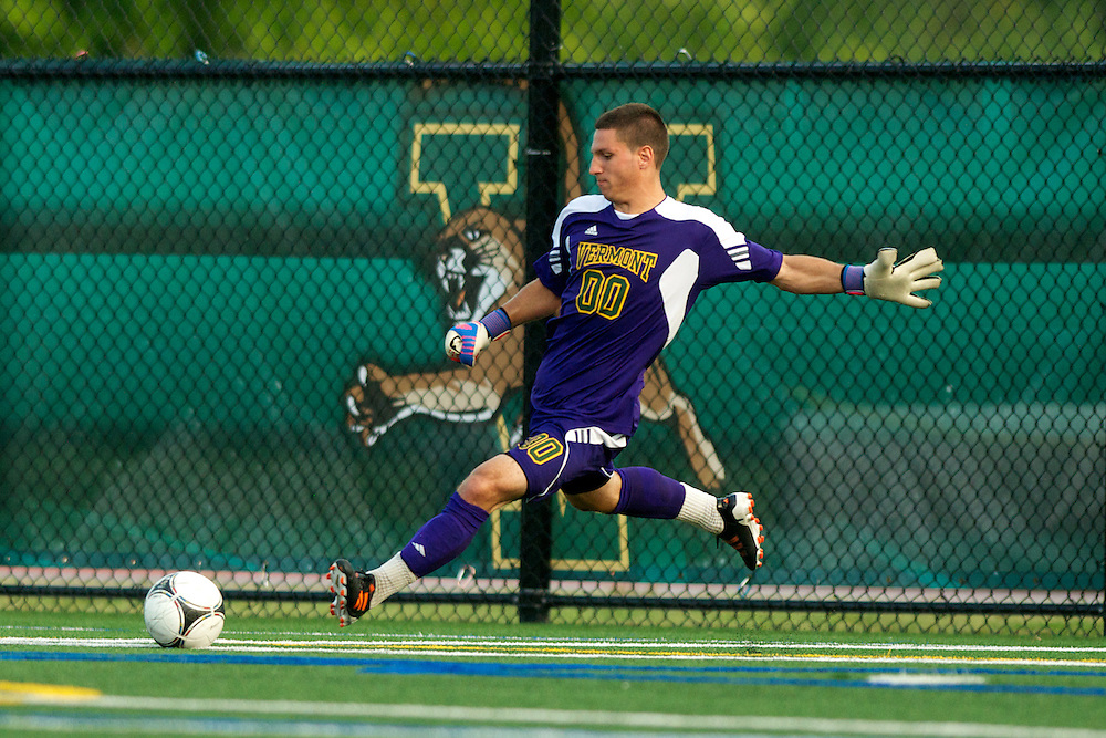 Catamounts goalie Conor Leland (00) kicks the ball during the men's soccer game between the Central Connecticut State University Blue Devils and the Vermont Catamounts at Virtue Field on Friday afternoon September 7, 2012 in Burlington, Vermont.