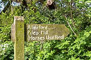 Footpath sign to Allerford and Piles Mill at West Luccombe in Exmoor, Somerset, UK