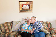 """Charles Stover, 81, of Amesville, Ohio, kisses his girlfriend Joan Allbaugh after seeing the photographer's camera pointed toward him at his home in Amesville, Ohio, Nov. 11, 2011. The couple started dating several months after Stover's wife of 62 years passed away in January of 2011, though Allbaugh had not dated anyone else since her husband passed away in 1989. Stover said, """"I just never thought at my age that it would ever happen again."""""""