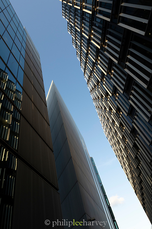 Low angle view of modern skyscrapers against blue sky, London, England, UK