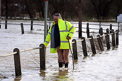 © Licensed to London News Pictures. 02/12/2014<br /> Yalding Flooding a year ago.<br /> <br /> Yalding resident Bill Bird walking along Lees Road in Yalding  on  03/01/2014<br /> The Medway River in Yalding has burst its banks again flooding Large parts of Yalding including Little Venice Country Park and The Lees.<br /> Flood waters are back again in Kent as Gales and heavy rain hit the UK over night.<br /> Photo credit :Grant Falvey/LNP