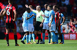 Raheem Sterling of Manchester City confronts Referee Mike Dean after being sent off. - Mandatory by-line: Alex James/JMP - 26/08/2017 - FOOTBALL - Vitality Stadium - Bournemouth, England - Bournemouth v Manchester City - Premier League