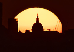 © Licensed to London News Pictures. 07/05/2021. London, UK. The morning sun rises behind St Paul's Cathedral in central London. Colder wetter weather is expected over the weekend and into next week. Photo credit: Peter Macdiarmid/LNP