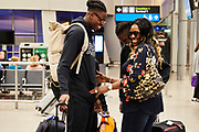 DUBLIN, IRELAND - August 12, 2018:  Aidan arrives from New York City at Dublin Airport to an emotional greeting by his mother Nibo. They have not seen each other in 2 years.<br /> <br /> Aidan Harris-Igiehon was born in Ireland. Aidan moved to the United States at the age of 12 to pursue his dreams of becoming a professional basketball player. Growing up in Ireland, basketball is not a traditional sport in the country so once Aidan saw some promise and potential he knew that moving to America was his only option. At the age of 12 Aidan had already outgrown his classmates and even dunked his first basketball in middle school. He had to leave his mother in Ireland and went on to live with his Aunt and Uncle in Brooklyn, NY where he would being to start a new life and pursue basketball. <br /> <br /> Aidan had went on to refine his skills and continue to grow - 6'10 240 pounder by the time he was a junior at Lawrence Woodmere Academy in New York. He became a top 50 National prospect and sought after by colleges across the country. This is Aidan's first time seeing his family and friends in 2 years and the first back home since all of the national recognition. Ireland had scheduled a week long of camps and exhibitions that would be featuring Aidan.<br /> <br /> Photo by: Johnnie Izquierdo