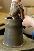 Making Bizen pottery. Bizen city, Okayama Pref, Japan, January 29, 2014. The city of Bizen in central Japan is famous for Bizen-ware pottery. It is also one of Japan's main traditional sword making regions, home to Osafune sword-makers and polishers.