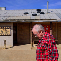 Les Wilson stands outside the trading post that he bought in 1983 in Two Grey Hills Tuesday. The trading post was established in 1897 and Wilson says one of the last trading posts that still functions in the traditional way.