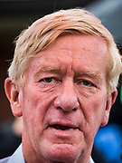 11 AUGUST 2019 - DES MOINES, IOWA: BILL WELD campaigns in the rain at the Iowa State Fair Sunday. Weld, a two term former governor of Massachusetts, is running to be the Republican nominee for President in 2020. He campaigned at the Iowa State Fair Sunday. He is launching a primary bid against incumbent Donald Trump in New England states and some western states where Trump is not popular.         PHOTO BY JACK KURTZ