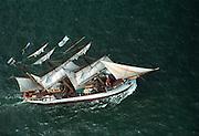 Aerial view: Sailing ship Picton Castle under way during Operation Sail between Lynhaven & Ft Monroe Hampton Roads, Virginia. Chesapeake Bay Region.