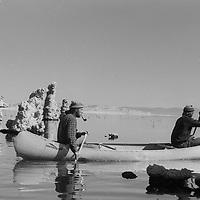 Michael Hock and Roger Schley canoe between tufa towers on Mono Lake near Lee Vining, California.  Circa 1973