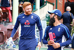 England's Jonny Bairstow and Moeen Ali during day five of the Ashes Test match at Sydney Cricket Ground.