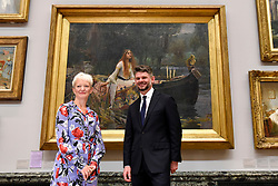 "© Licensed to London News Pictures. 05/09/2018. LONDON, UK.  Maria Balshaw, Director of Tate, and Nick Mitzevich, Director of the National Gallery of Australia, pose with ""The Lady of Shalott"", 1888, by John William Waterhouse, at Tate Britain, to mark the launch of a major new exhibition at the National Gallery of Australia (NGA) in December 2018.  Over forty Pre-Raphaelite works will be loaned by Tate to NGA, which have never been shown in Australia until now, including ""Ophelia"", 1851-52, by John Everett Millais and ""The Lady of Shalott"", 1888, by John William Waterhouse.  Photo credit: Stephen Chung/LNP"