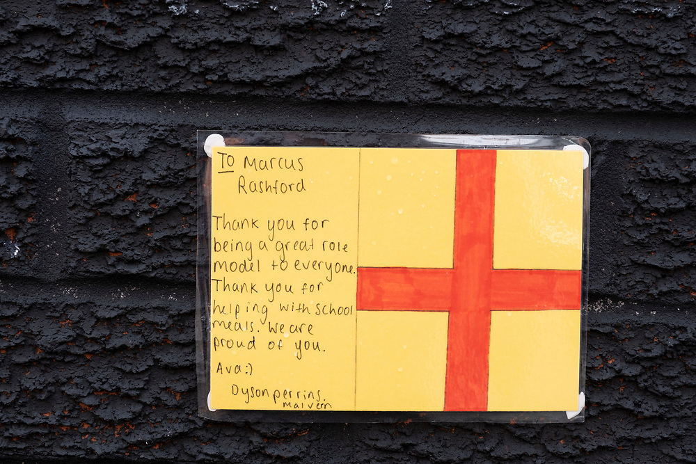 Letters of support attached to the wall of the Marcus Rashford mural displayed on the side of a cafe in Withington, south Manchester on the 6th of August 2021, Manchester, United Kingdom.  The mural has attracted huge numbers of people since the Euro 2020 final between England and Italy on 11 July and the subsequent racist abuse levied at Rashford and other Black players on the England team. Based on a photograph by Daniel Cheetham, the painting of Marcus Rashford was completed in 2020 by street artist Akse, in collaboration with the street art project Withington Walls, to commemorate the footballer's work to reduce child hunger. (photo by Andrew Aitchison / In pictures via Getty Images)