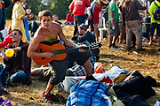 New age guitarist the morning after in the stone circle, Glastonbury Festival 2010