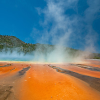 Steam rises from Grand Prismatic Spring - North America's largest hot spring - in Wyoming's Yellowstone National Park. The vivid colors are from pigmented bacteria that thrive in hot water.