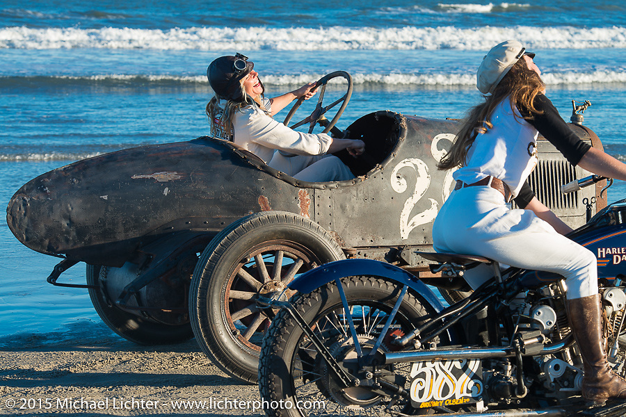 Brittney Olsen on the One of One Harley-Davidson (built by her husband Matt for Michael Detwiler)alongside Jessi Combs in Bobby Green's Overland Whippet as they pose for painter David Uhl at The Race of Gentlemen. Wildwood, NJ, USA. October 11, 2015.  Photography ©2015 Michael Lichter.