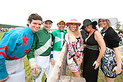 9  April, 2011:  Jockeys (Left to Right) Liam McVicar, Carl Rafter and Richard Boucher pose with fans while raising money for the injured jockeys fund.