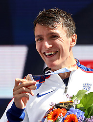 Great Britain's Jake Wightman holds his bronze medal won in the Men's 1500m, during day five of the 2018 European Athletics Championships at the Olympic Stadium, Berlin.