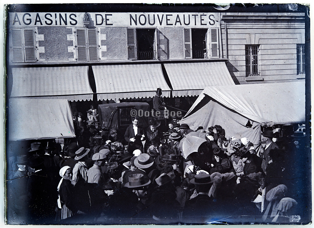 Paris street market with VIP people arriving 1920s France