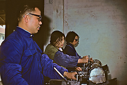 People Working At Factory For Disabled