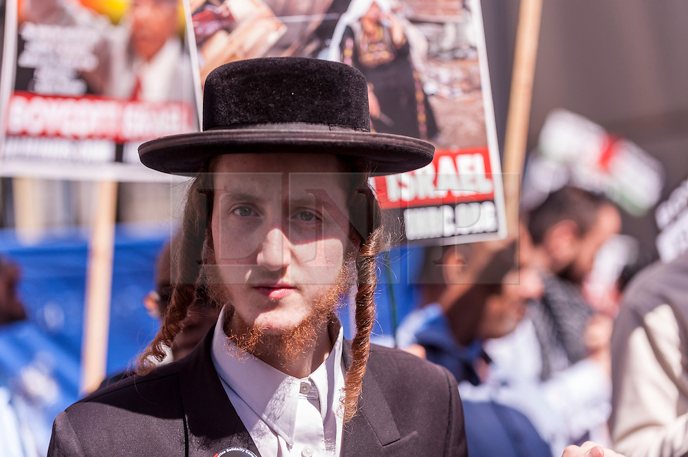 © Licensed to London News Pictures. 10/07/2015. London, UK. Demonstrators gather outside the BBC building near Oxford Circus at the start of the annual Al Quds Day annual demonstration and rally in support of Palestine. Photo credit : Stephen Chung/LNP