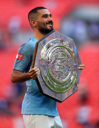 Manchester City's Ilkay Gundogan with the trophy after the Community Shield match at Wembley Stadium, London.