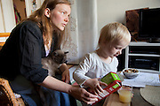 Astrid Holmann of the Hollmann Sturm family in Hamburg, Germany with her daughter Lillith Sturm. They were photographed for the Hungry Planet: What I Eat project with a week's worth of food in June. Model Released.