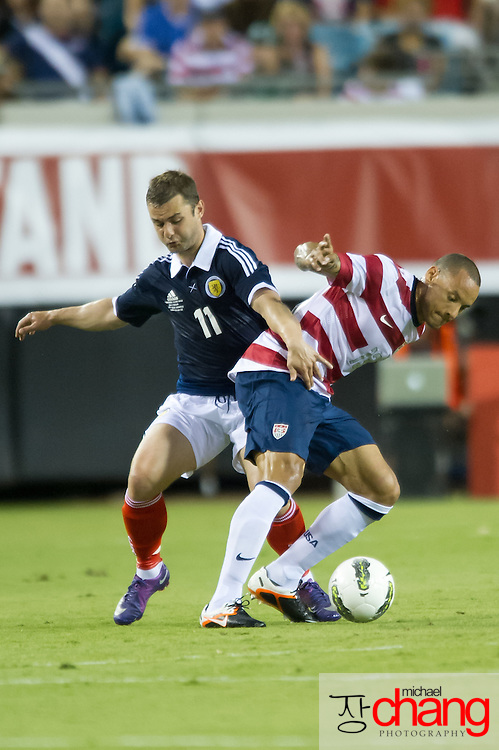 May 26 2012: USA's Jermaine Jones (13) tries to maneuver around Scotland's Shaun Maloney (11) during the first half of play of the U.S. Men's National Soccer Team game against Scotland at Everbank Field in Jacksonville, FL. USA defeated Scotland 5-1.