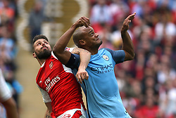 23 April 2017 FA Cup semi-final : Arsenal v Manchester City :<br /> Olivier Giroud of Arsenal gets in a tangle with Vincent Kompany.<br /> Photo: Mark Leech