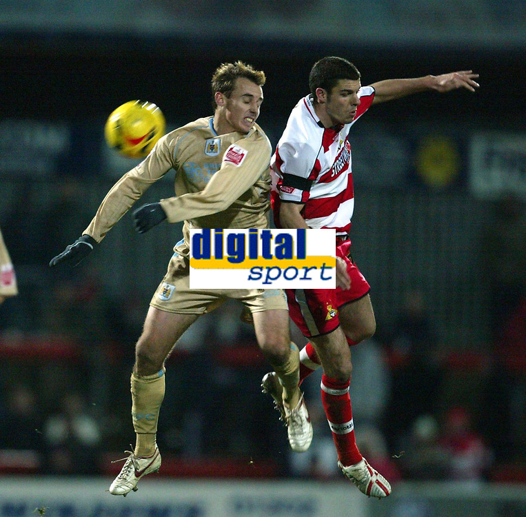 Photo: Aidan Ellis.<br /> Doncaster Rovers v Bristol City. Coca Cola League 1.<br /> 26/11/2005.<br /> Bristol's Luke Wilkshire battles with Doncaster's Lewis Guy