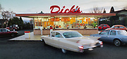 A 1960 Cadillac at Dick's Drive-In in Wallingford, where golden memories of cars, burgers and fries are close to the surface. (Craig Fujii / The Seattle Times, 1999)