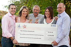 Family Syndicate, Brothers Ian and Mark and Dad Les Holmes all from Doncaster collect £6,722,094 in National Lottery Win.27 October 2010 .Images © Paul David Drabble