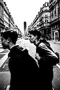 April 2015. Paris. a couple of boys crossing the street.