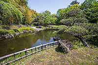 """Hiratsuka Japanese Garden was built in 1989 as a strolling garden with excursion trails arranged around a pond. The scenery contrived is of:  mountain, forest and water.  At the southern end a stairway you enter the """"mountain"""" zone with trees that gives off an atmosphere of the heart of a mountain. The pond and arbor are seen in the other side of Takebayashi pavilion. The garden also has one additional treat, a suikinkutsu or Japanese water harp."""