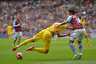 Emre Can of Liverpool (c) trips over the ball. The FA Cup, semi final match, Aston Villa v Liverpool at Wembley Stadium in London on Sunday 19th April 2015.<br /> pic by John Patrick Fletcher, Andrew Orchard sports photography.