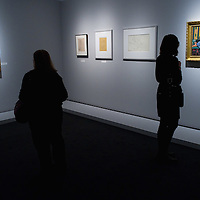 """BRESCIA, ITALY - FEBRUARY 11:  Visitors admire paintings and drawings of the Odalisques serie by Matisse at the  Santa Giulia Museum on February 11, 2011 in Brescia, Italy. The exhibition """"Matisse La Seduzione di Michelangelo"""" shows  180 works of the French artist and will stay open until June 12th 2011"""