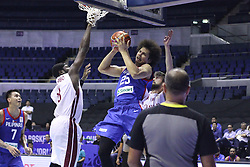 September 17, 2018 - Quezon City, NCR, Philippines - Japeth Aguilar (Blue) of the Philippines tries to lay the ball over defenders Tanguy Alban H Ngombo (8, White) and Nasser Khaifa Al-Rayes (42, White) of Qatar. (Photo by Dennis Jerome Acosta/ Pacific Press) (Credit Image: © Dennis Jerome S. Acosta/Pacific Press via ZUMA Wire)