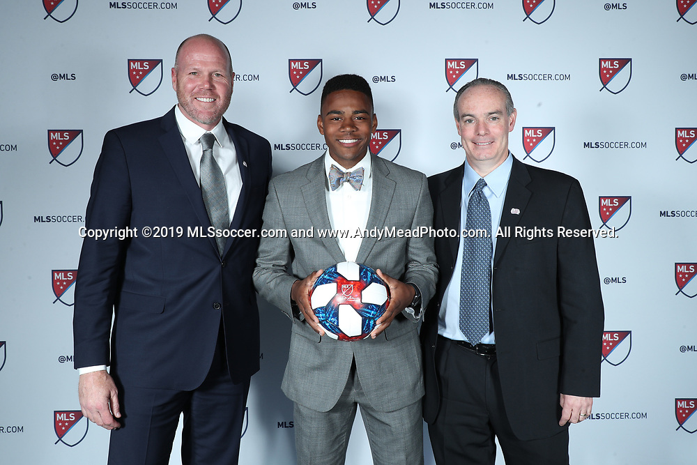 CHICAGO, IL - JANUARY 11: DeJuan Jones was taken with the eleventh overall pick by the New England Revolution. With head coach Brad Friedel (left) and general manager Mike Burns (right). The MLS SuperDraft 2019 presented by adidas was held on January 11, 2019 at McCormick Place in Chicago, IL.