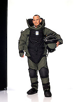 """Detective, NYC Bomb Squad<br /> <br /> On vacation, he reported to the 6th Precinct on 10th Street. <br /> <br /> """"I was on a response team that covered packages coming into the city. I put on a bomb suit - 75 layers of kevlar with metal plates in front. I'm very saddened by the attack. I lost my best buddy, Claude Richards, who was evacuating people at the towers. The disaster brought me much, much closer to my family and friends."""""""