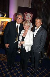Left to right, STEPHEN WAY, GLORIA HUNNIFORD and her son MICHAEL KEATING at a reception to launch Angel themed Christmas Cards and view an exhibition of the original art work by Gordon King with proceeds going to the Caron Keating Foundation  held at the Langham Hotel, Portland Place, London on 20th November 2006.<br />