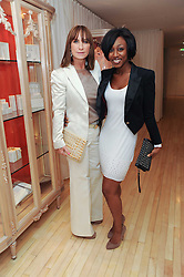 Left to right, MEG MATTHEWS and BEVERLEY KNIGHT at a private dinner for the White Ribbon Alliance's Global Dinner Party Campaign, at Agua, Sanderson Hotel, Berners Street, London on 4th March 2010.