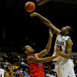 January 17, 2012; Baton Rouge, LA; LSU Tigers forward Storm Warren (24) blocks a shot by Auburn Tigers guard Chris Denson (3) during the second half of a game at the Pete Maravich Assembly Center. LSU defeated Auburn 65-58 in overtime. Mandatory Credit: Derick E. Hingle-US PRESSWIRE