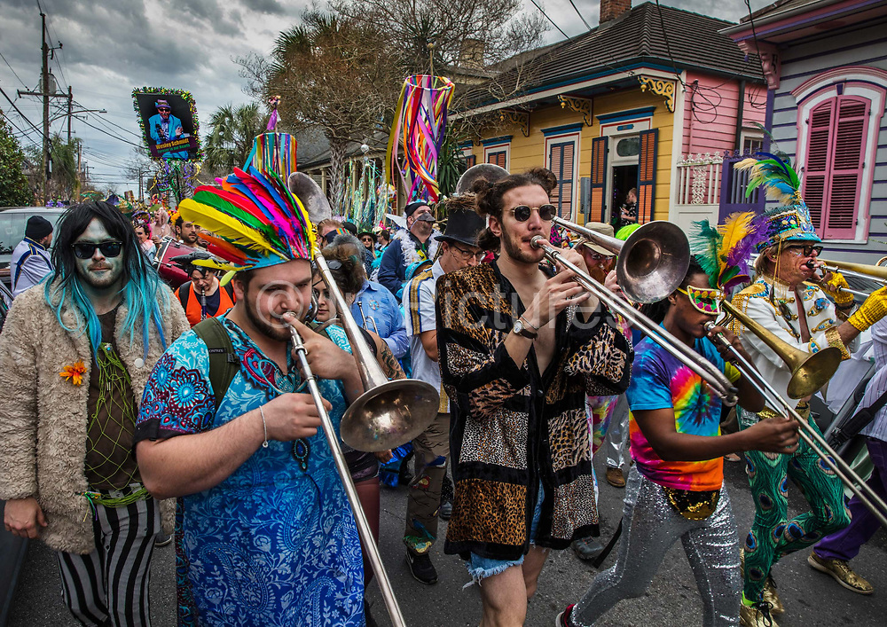 Storyville Stompers brass band providing the music to the Society of Saint Anne parade during Mardi Gras on 25th February 2020 in Bywater district of New Orleans, Louisiana, United States. Mardi Gras is the biggest celebration the city of New Orleans hosts every year. The magnificent, costumed, beaded and feathered party is laced with tradition and  having a good time. Celebrations are concentrated for about two weeks before and culminate on Fat Tuesday the day before Ash Wednesday and Lent.