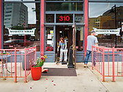 31 MAY 2020 - DES MOINES, IOWA: TAMMY VANNONI, general manager of the Spaghetti Works, and FRANK SINGLETON, from Elite Glass and Metal, clean up the front of Spaghetti Works, a popular restaurant in downtown Des Moines, after rioters shattered the windows. A group of rioters, protesting the death of George Floyd in police custody in Minneapolis, smashed windows in businesses and restaurants around the Polk County Courthouse in Des Moines. Des Moines police said they made 25 arrests Saturday night and very early Sunday morning. No one was hurt in the disturbances.     PHOTO BY JACK KURTZ