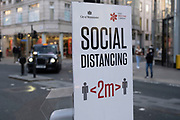 Socialdistancing sign on Oxford Street as Londoners await the imminent end of the second coronavirus national lockdown before the capital enters tier two in the new three tier system on 1st December 2020 in London, United Kingdom. Non essential shops will be allowed to reopen as of 2nd December while in other areas of the country, controversially, they will have to remain closed.