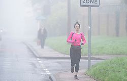 © Licensed to London News Pictures. 07/12/2020. <br /> Crockenhill, UK. A lady running in the cold weather today in Crockenhill, Kent. The Met Office has issued a yellow weather warning for the UK from the South coast to the Midlands for freezing foggy weather conditions with low visibility in some places. Photo credit:Grant Falvey/LNP