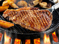 Sirloin beef steaks & chips being pan fried on a bbq. Meat food photos, pictures & images.