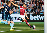 Football - 2016 / 2017 Premier League - West Ham United vs. Middesborough <br /> <br /> Dimitri Payet of West Ham with a strike at the Middlesborough goal at The London Stadium.<br /> <br /> COLORSPORT/DANIEL BEARHAM