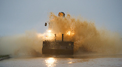 © Licensed to London News Pictures. 25/11/2012..North East England..A JCB splashes through a heavily flood road following overnight rain that caused traffic disruption and flooding in parts of Cleveland and North Yorkshire this morning...Photo credit : Ian Forsyth/LNP